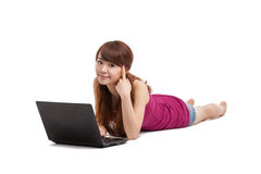 Asian woman lying down with laptop Stock Photography