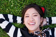 Asian woman lying on the grass Royalty Free Stock Photos