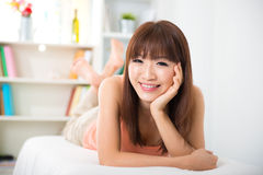 Asian woman lying on sofa Royalty Free Stock Photo