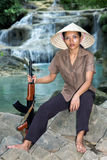Asian woman with a machine gun Stock Image