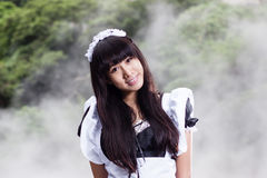 Asian woman in maid outfit Royalty Free Stock Images