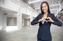 Asian woman make heart synbol on logistic business. Background, love, manager, service, interpreter, professional, participant, office, advice, preparation royalty free stock photos