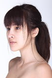 Asian Woman before make up hair style. no retouch, fresh face wi. Th nice and smooth skin. Studio lighting white background royalty free stock image