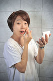 Asian woman makeing up her face. With mirror Royalty Free Stock Photography