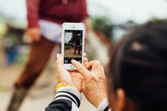 Asian woman making photo on smartphone Stock Photography