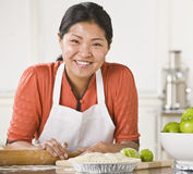 Asian woman making pie. Royalty Free Stock Image