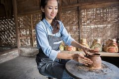Woman artist making pottery Stock Photography