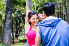 Asian woman and man gymnastics stretching Stock Images