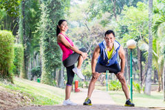 Asian woman and man gymnastics stretching Stock Photography