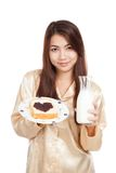 Asian woman with milk bottle , bread and heart shape berry jam Royalty Free Stock Photo