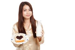 Asian woman with milk bottle , bread and heart shape berry jam Royalty Free Stock Image