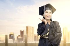 Asian woman in mortarboard hat graduating from college stock photos
