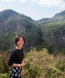 Asian woman in mountain backgroud, Chiang Mai,Thailand Royalty Free Stock Photo