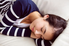 Asian woman napping on the couch Royalty Free Stock Image