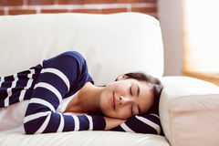 Asian woman napping on the couch Royalty Free Stock Photos