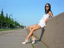 Asian woman near wall Stock Image