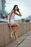 Asian woman near wall Stock Images