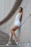 Asian woman near wall Royalty Free Stock Photography
