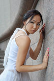 Asian woman near wall Stock Photography