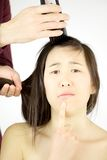 Asian woman not sure to shave her long hair Royalty Free Stock Photography