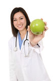 Asian Woman Nurse with Apple Stock Image