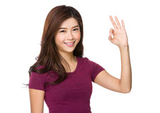 Asian woman with ok sign Royalty Free Stock Image