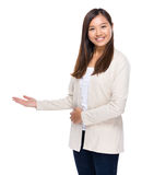 Asian woman with open hand palm Royalty Free Stock Images