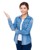 Asian woman with open hand palm Royalty Free Stock Photography