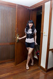Asian woman opening a hotel room Royalty Free Stock Photos