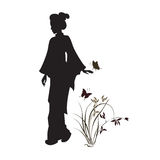 Asian woman, orchid and butterfly. Stock Image