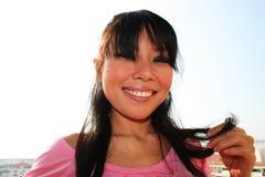 Asian woman outdoors. Stock Photo