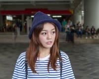 Asian woman outside subway station Royalty Free Stock Image