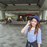 Asian woman outside subway station Royalty Free Stock Photos