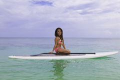 Asian woman on a paddle board Royalty Free Stock Images