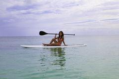 Asian woman on a paddle board Stock Photo