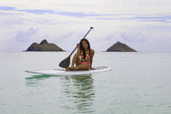Asian woman on a paddle board Stock Photos