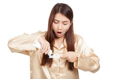 Asian woman in pajamas yawn with toothbrush and toothpaste Stock Images
