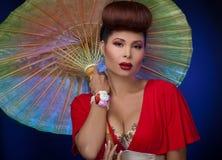 Asian woman with parasol Royalty Free Stock Photos