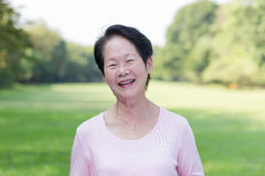 Asian woman in the park. Portrait of Asian senior woman in the park Stock Images