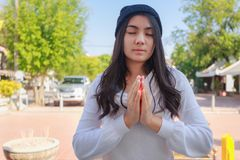 Asian woman pay homage to a Buddha image stock images