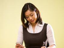 An asian woman paying bills online Stock Images
