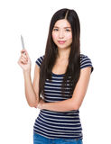 Asian woman with pen pointing up Royalty Free Stock Photo