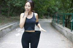 Woman with a perfect figure doing sports, fitness, drinking water stock photos