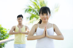 Asian woman performing yoga. Stock Images