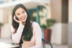 Asian woman on the phone royalty free stock photography