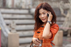 Asian woman phoning Royalty Free Stock Photography