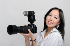 Asian woman with photo camera Stock Images
