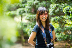 Asian woman photographer in nature Royalty Free Stock Images
