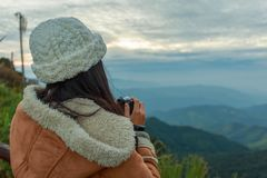 Photographer taking photo of landscape from top of the mountain Stock Photography