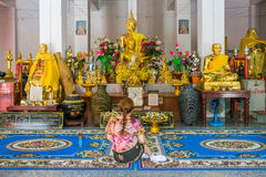 Asian woman pilgrim worships the Buddha statue in hall of Wat Pha Tung Royalty Free Stock Images